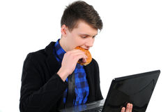 Fast food. Busy hardworking business man eats lunch while working Royalty Free Stock Photography