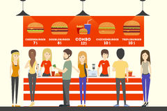 Fast food cashier. People in uniform sell the food to customers. Burgers, french fries and drinks Stock Image