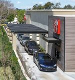 Irvine, CA, USA - April 16, 2018: Cars lined up at the drive thru window of Chick-fil-A. Fast food chain restaurant that makes chicken sandwiches their Royalty Free Stock Photography