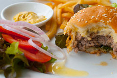Fast food cheeseburger Stock Image