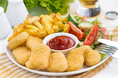 Fast food - chicken nuggets, french fries and vegetable salad Stock Photography
