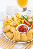 Fast food - chicken nuggets, french fries and vegetable salad Stock Photo