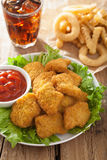 Fast food chicken nuggets with ketchup, french fries, cola Stock Photos