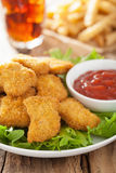 Fast food chicken nuggets with ketchup, french fries, cola Royalty Free Stock Image