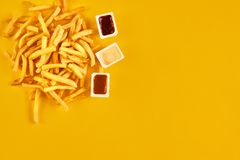 Fast food concept with greasy fried restaurant take out as onion rings, burger, fried chicken and french fries as a Royalty Free Stock Photo