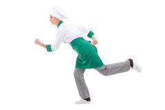 Fast food concept - happy woman in chef uniform running isolated Royalty Free Stock Photography