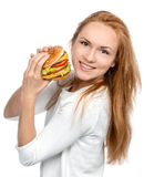 Fast food concept. Tasty unhealthy burger sandwich in hands hung Stock Photography