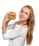 Fast food concept. Tasty unhealthy burger sandwich in hands hung Royalty Free Stock Image