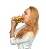 Fast food concept. Woman eating tasty unhealthy burger sandwich Stock Photo