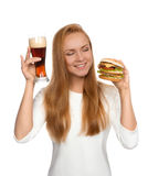 Fast food concept. Woman hold tasty unhealthy burger sandwich in Stock Photography