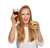 Fast food concept. Woman hold tasty unhealthy burger sandwich Stock Photos