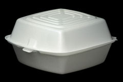 Fast Food Container on Black. White polystyrene fast food container isolated on black Stock Image