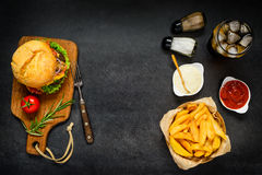 Fast Food with Copy Space Area. Top View of Fast Food Burger, French Fries and Cold Cola with Copy Space Stock Photo
