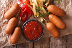 Fast Food: Corn dogs, french fries and ketchup close-up. horizon Stock Photo