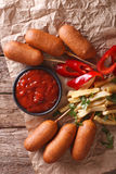 Fast Food: Corn dogs, french fries and ketchup close-up. Vertica Stock Photography