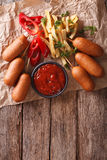 Fast Food: Corn dogs, french fries and ketchup. Vertical top vie Royalty Free Stock Image