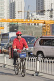 Fast food courier during rush hour in Beijing, China Royalty Free Stock Images