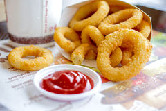Fast food crunchy fried onion rings. In breading close-up Royalty Free Stock Photography