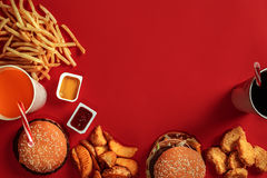 Free Fast Food Dish Top View. Meat Burger, Potato Chips And Glass Of Drink On Red Background. Takeaway Composition. Royalty Free Stock Photos - 94376988