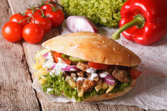 Fast Food: Doner kebab with meat, vegetables and french fries Royalty Free Stock Image