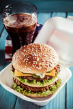 Fast food double cheeseburger with a soda Stock Photos