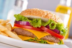 Fast food eat. Burger and French Fries on the plate. Stock Photo