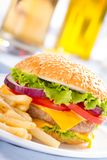 Fast food eat. Burger and French Fries on the plate. Royalty Free Stock Photo