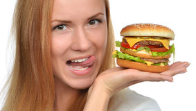 Fast food eating concept Woman hold cheeseburger sandwich with c Stock Photos