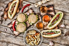 Fast-Food, Food Festival. Food Buffet Catering Dining Eating Party Sharing Concept. Food Festival. All kinds of fast food. hot dog. S, hamburgers, traditional Royalty Free Stock Images