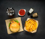 Fast Food with French Fries, Cola and Burger. Top View of Burger Sandwich, French Fries and Cold Ice Cola Stock Image