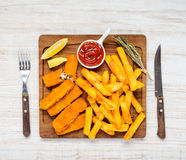 Fast Food with French Fries and Fish Fingers Royalty Free Stock Photography
