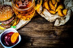 Fast food and a glass of light beer. Place for your text stock image