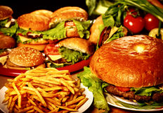 Fast food hamburger and french fries for large group friends. Royalty Free Stock Images