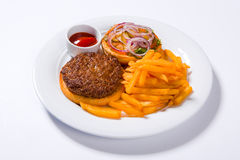 Fast food hamburger and french fries on a white plate Stock Photo