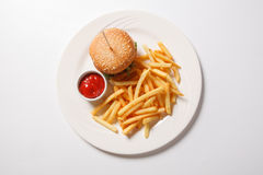 Fast food hamburger and french fries on a white plate Royalty Free Stock Photos