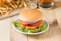 Fast food hamburger with french fries on wooden background. Royalty Free Stock Photos