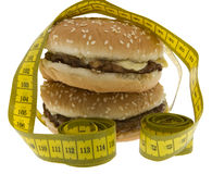 Fast food, Hamburger with measuring tape Royalty Free Stock Photography