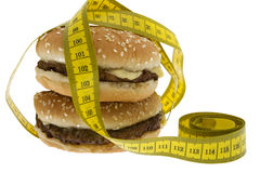 Fast food, Hamburger with measuring tape Royalty Free Stock Photo