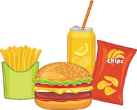 Fast food. Hamburger, orange drink, potato chips and french fries Royalty Free Stock Photo