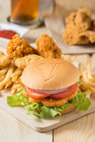 Fast food hamburger with set fried chicken and french fries. Royalty Free Stock Photography