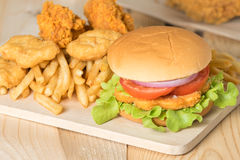 Fast food hamburger with set fried chicken and french fries. Stock Photo