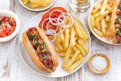 Fast food - hot dog with French fries and chips, top view Royalty Free Stock Photography