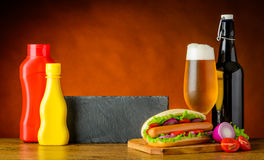 Fast Food Hot Dog Sandwich with Beer and Copy Space Stock Photography