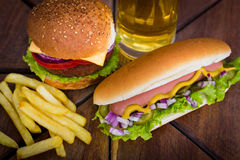Fast food - Hot dogs, hamburger and French fries Royalty Free Stock Photography