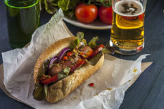 Fast food: hotdog, beer bottle and glass Stock Photo