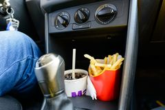 Free Fast Food In A Car: Cold Beverage And Delicious Fries Stock Photography - 119787372