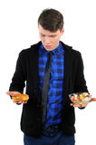 Fast food. Isolated young man with burgers and salad Stock Photo