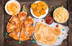 Fast food or junk food background top view. Royalty Free Stock Image