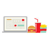 Fast Food Beside Laptop For Worker Royalty Free Stock Photos