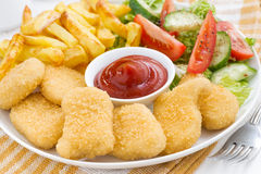 Fast food lunch with chicken nuggets, french fries and salad Stock Photography